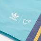 Мужские шорты adidas Originals x Human Made Wind Light Aqua/St. Fade Gold фото - 1