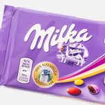 Шоколад Milka & Bunte Kakaolinsen 100g фото- 1
