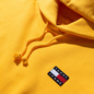 Женская толстовка Tommy Jeans Tommy Badge Hoodie Spectra Yellow фото - 1
