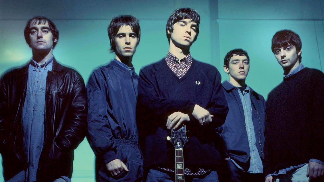 Группа Oasis иеелидер Ноэл Галлахер всвитере Fred Perry